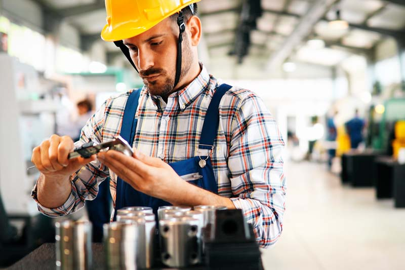 industrial-factory-employee-working-in-metal-manuf-DN2ESQ3